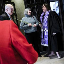Associate Pastor Rev. Niki Atkinson, right, greets and speaks with David Kemp, left, and Nora Kemp after Palm Sunday service at First Presbyterian Church in Greensburg, Pa., on Sunday, April 9, 2017.