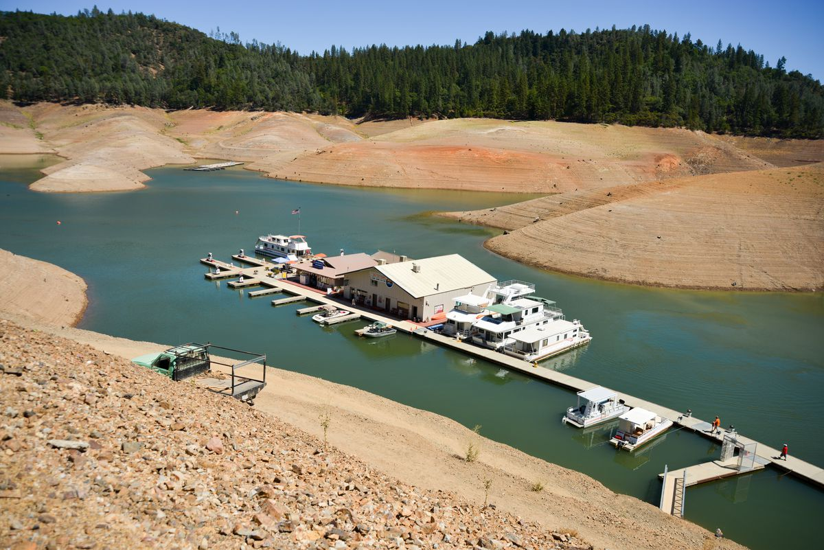 California's drought exposes the 180-200-foot drop in water levels at the Silverthorn Resort in 2014.