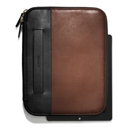 """<a href=""""http://f.curbed.cc/f/Coach_SP_121113_tablet"""">Bleecker tablet organizer in colorblock leather</a>, $298"""