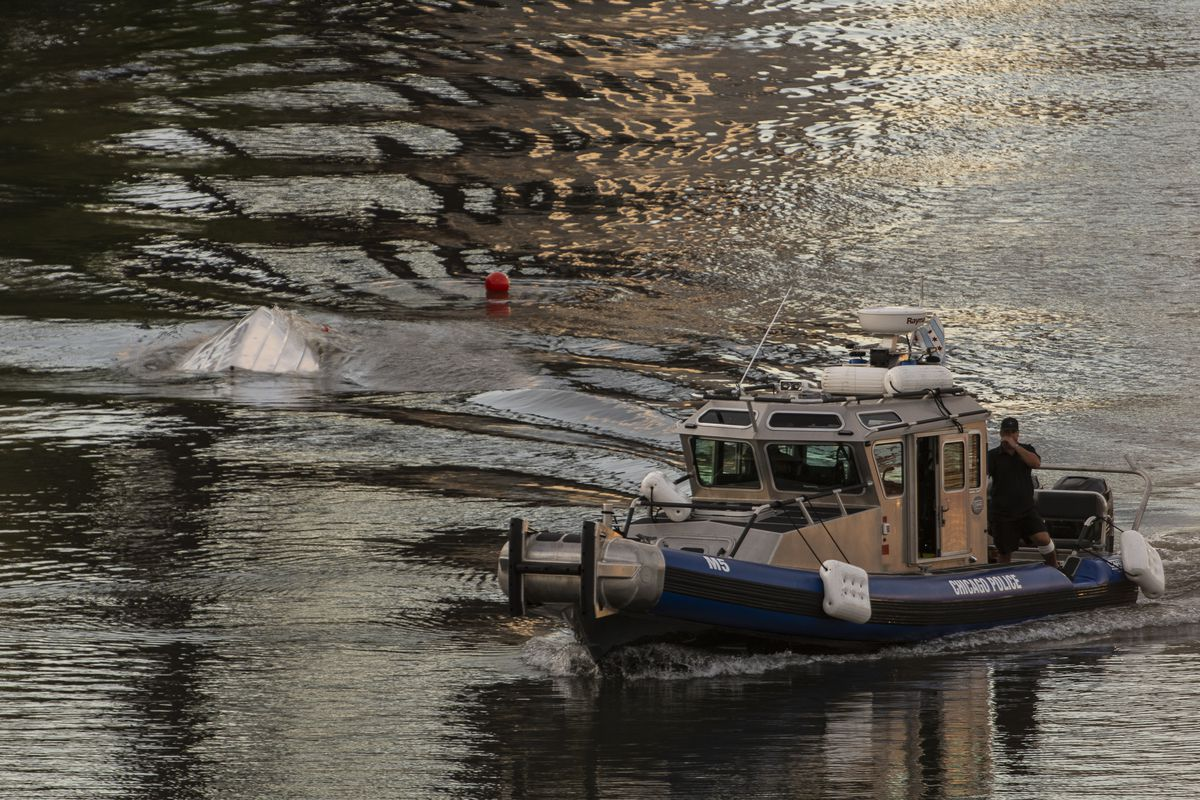 A Chicago Police Department vessel passes by the scene of a capsized boat that had been reported in the Chicago River near the 1400 block of South Lumber on Wednesday, July 22, 2020.