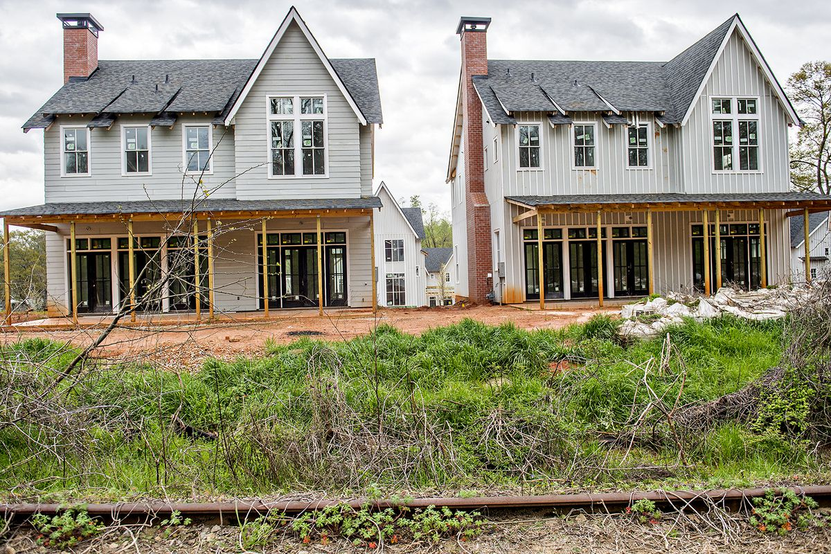 """A single-family community called """"The Farmhouses at Ormewood Park"""" rises earlier this year along the Beltline's Southside Trail corridor. Developers said in early 2017 home prices would start in the $600,000s."""