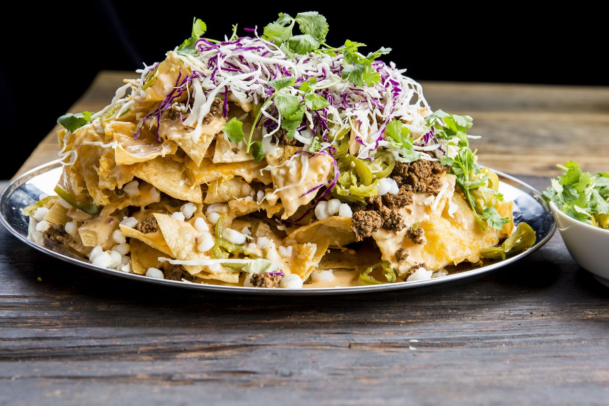 An entire platter of nachos, only available late at night.