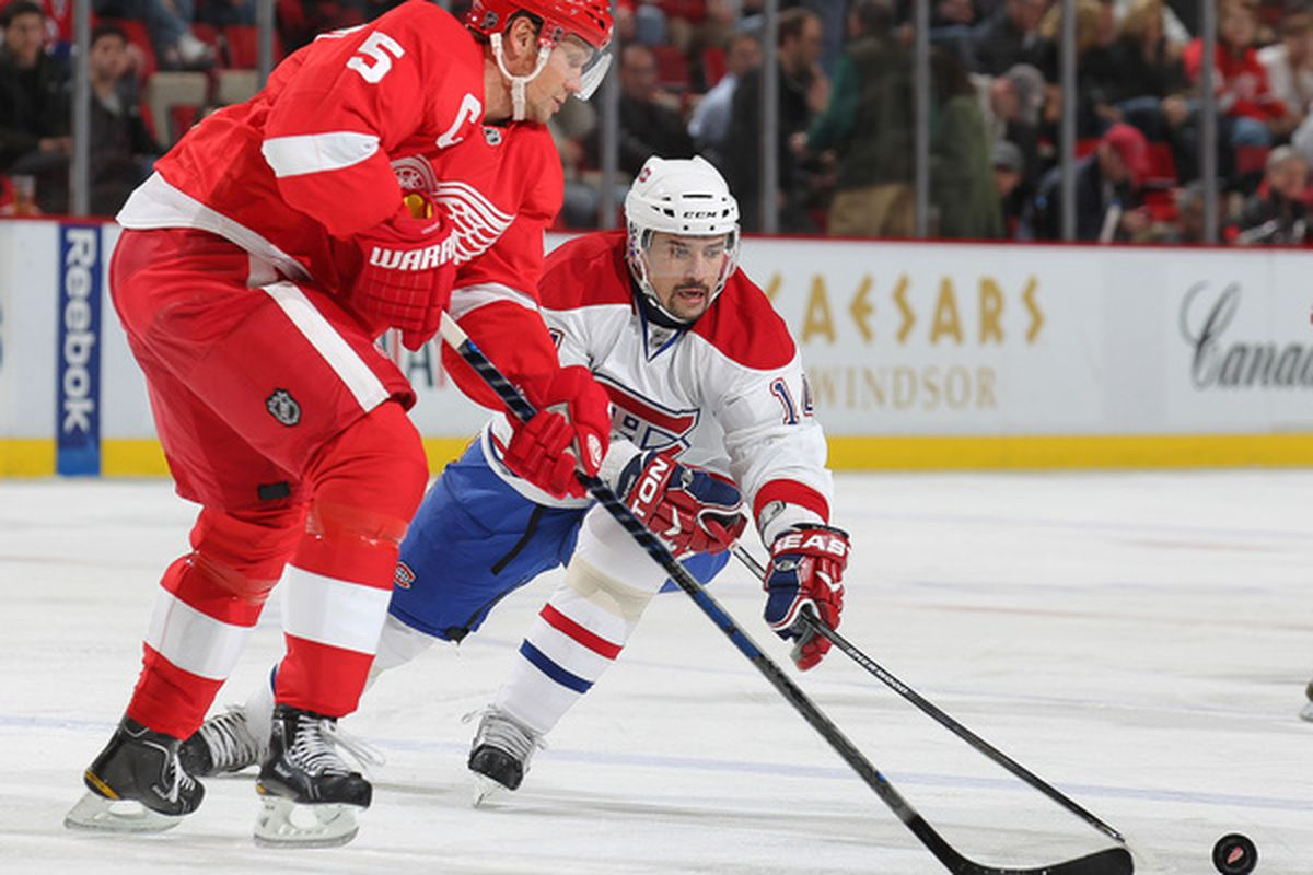 DETROIT,MI - DECEMBER 10:  Tomas Plekanec #14 of the Montreal Canadiens tries to check Nicklas Lidstrom #5 of the Detroit Red Wings in a game on December 10 2010 at the Joe Louis Arena in Detroit Michigan. (Photo by Claus Andersen/Getty Images)