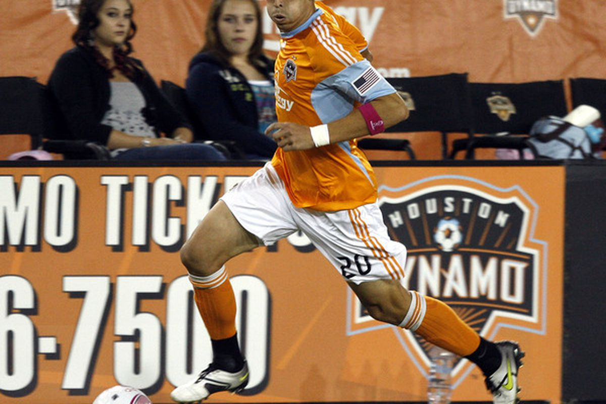 HOUSTON - OCTOBER 10:  Geoff Cameron #20 of the Houston Dynamo hustles the ball up the field against the New England Revolution at Robertson Stadium  on October 10, 2010 in Houston, Texas.  (Photo by Bob Levey/Getty Images)