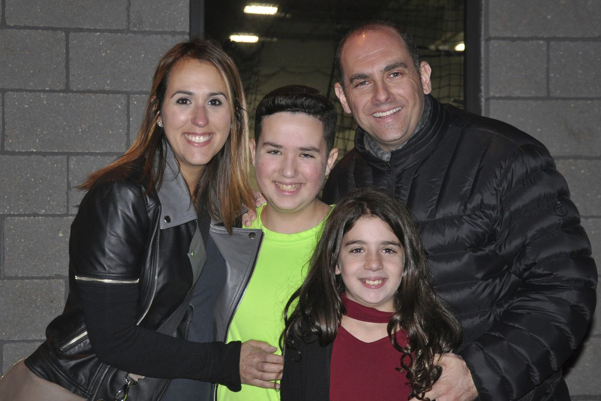 """This 2016 photo shows Jake Kestler (center) with his parents Gallite and Josh and sister Lily a month before he was diagnosed with a brain tumor called a glioma. Jake received a genetically modified type of herpes virus as an experimental treatment for the cancer when he was 12. """"He lived for a year and four months after that,"""" long enough to celebrate his bar mitzvah, go with his family to Hawaii and see a brother be born, Josh Kestler said."""