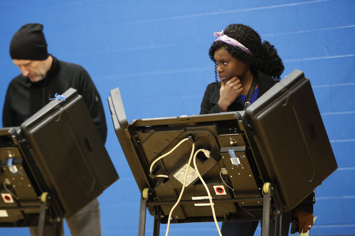 FILE - A voter waits for assistance from a volunteer at the Tuttle Park Recreation Center, Tuesday, Nov. 6, 2018, in Columbus, Ohio.