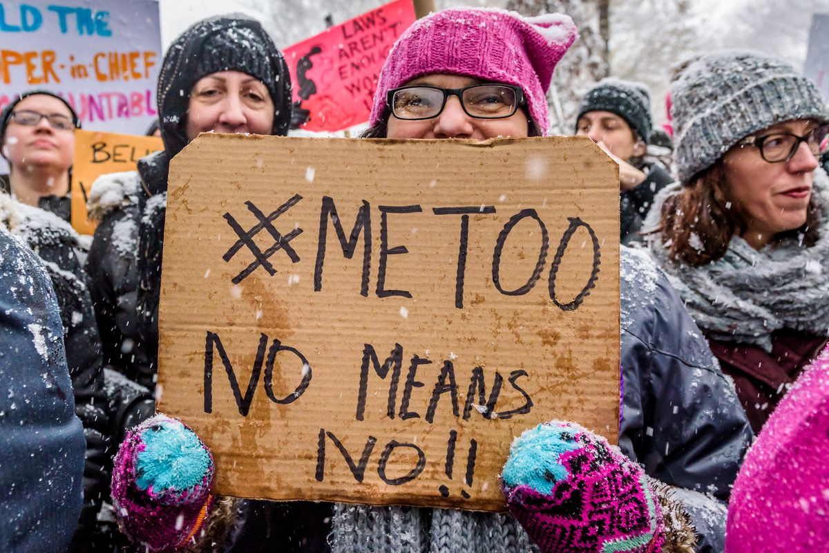 Protesters at a #MeToo rally in New York City in December 2017