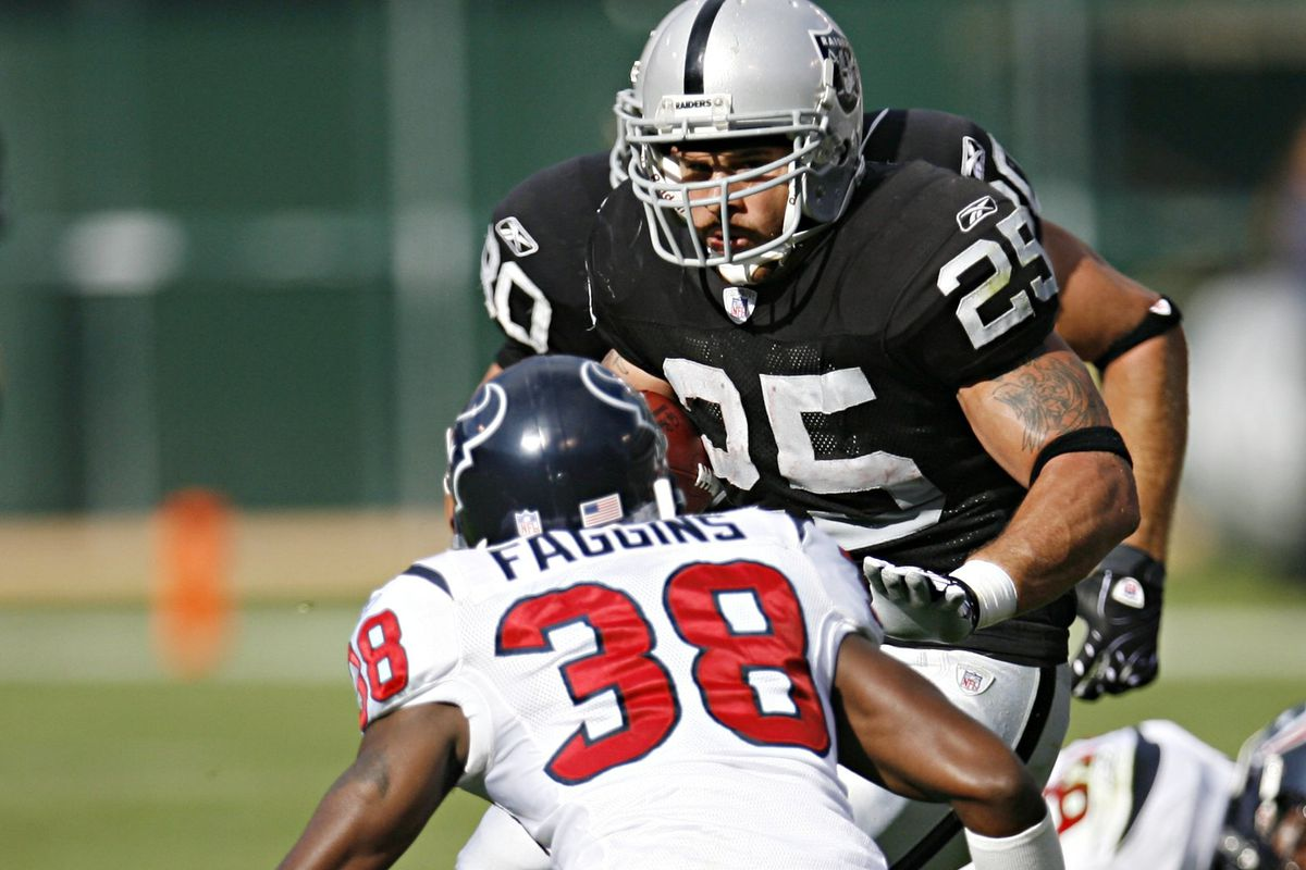 Oakland Raiders running back Justin Fargas (25) looks for a route around Houston Texans defender DeMarcus Faggins in the first quarter of their NFL football game, Sunday, Nov. 4, 2007 at McAfee Coliseum in Oakland, Calif. The Texans won, 24-17. (Nicole