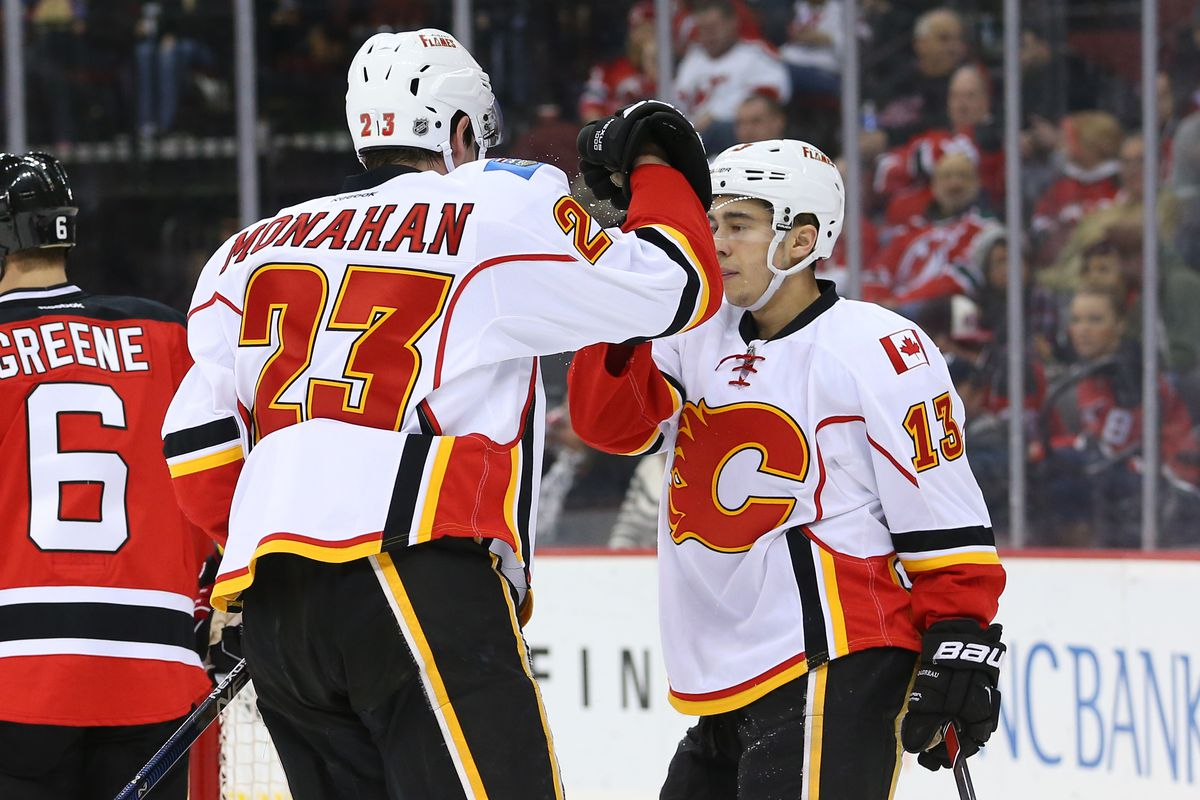 Mony and Johnny celebrate the first of 2 Flames goals.