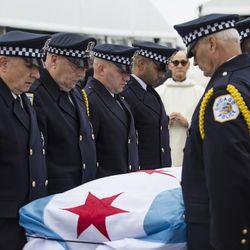 Pallbearers prepare to fold the flag that drapes Officer Jimenez's casket. | Ashlee Rezin/Sun-Times