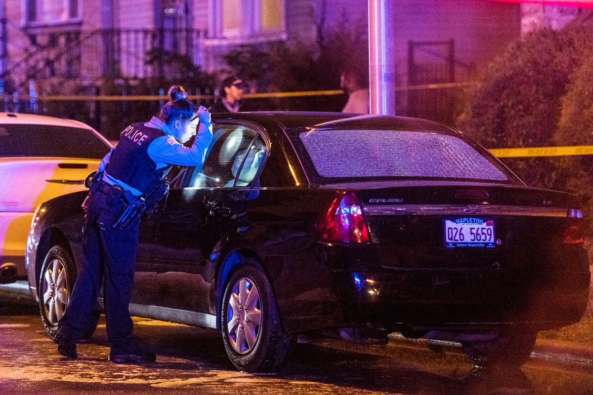 Police investigate a scene where multiple people were shot Sunday morning in the 6400 block of South Eberhart Ave. | Tyler LaRiviere/Sun-Times