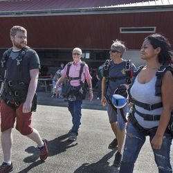 Jason Ashcroft, left, Wendell Ashcroft, Scotty Freeland, and Danielle Garrick walk out to the airplane to go skydiving at Skydive Ogden in Ogden on Saturday, Aug. 5, 2017.