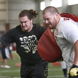 Utah's John Cullen, left, and Tony Bergstrom run through drills at Utah Pro Day where departing University of Utah senior football players and some invitees work out for NFL scouts in Spence Eccles Field House Friday, March 23, 2012, in Salt Lake City, Utah.