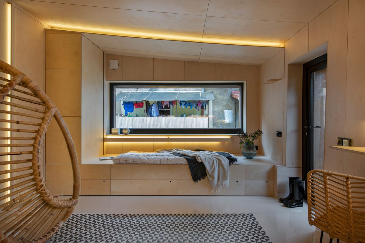 Bed next to window