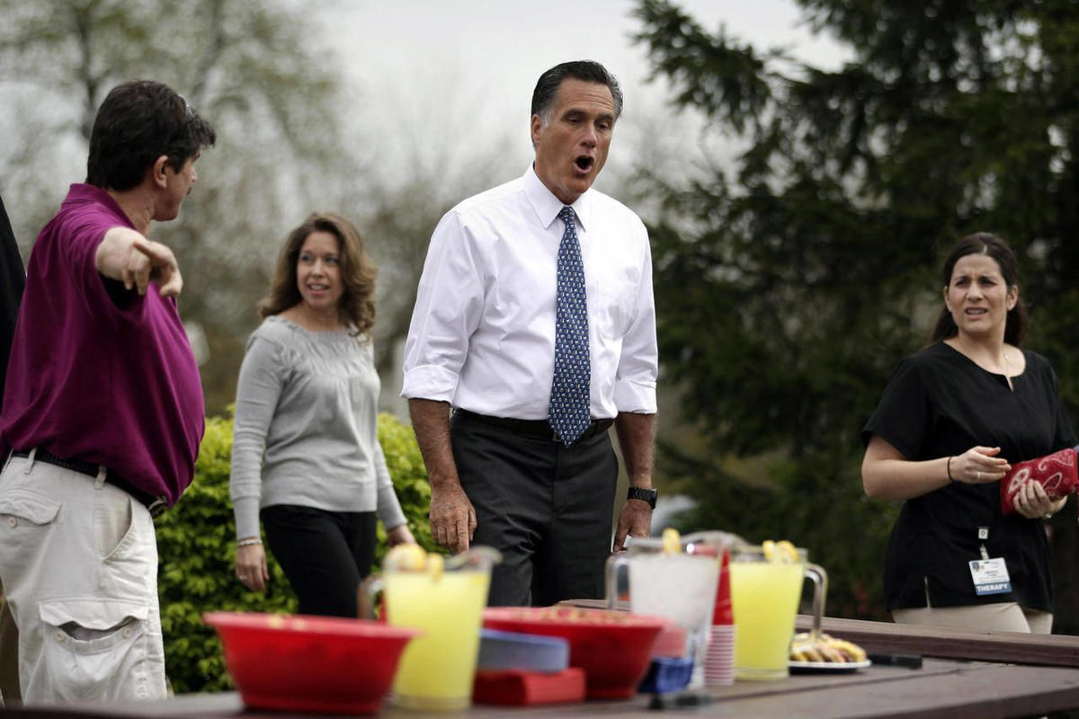 Republican presidential candidate, former Massachusetts Gov. Mitt Romney looks at a refreshment table as he arrives for a meeting with a group of Pittsburgh area residents in Bethel Park, Pa., Tuesday, April 17, 2012.
