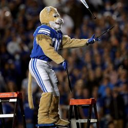 Cosmo juggles knives while balancing on a board on top of ladders as BYU and Utah play an NCAA football game at LaVell Edwards Stadium in Provo on Saturday, Sept. 11, 2021. BYU won 26-17, ending a nine-game losing streak to the Utes.