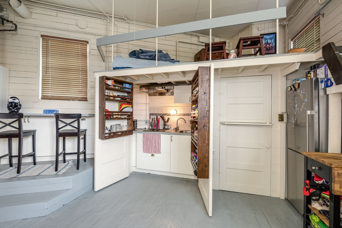 A small loft above a cabinet with a sink inside.