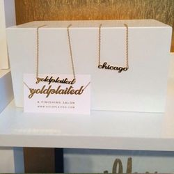 Goldplaited is now open on the border of Lincoln Park and Lakeview. And yes, its logo is modeled on Carrie Bradshaw's necklace (and similar trinkets are available for purchase.) Photos: Racked Chicago