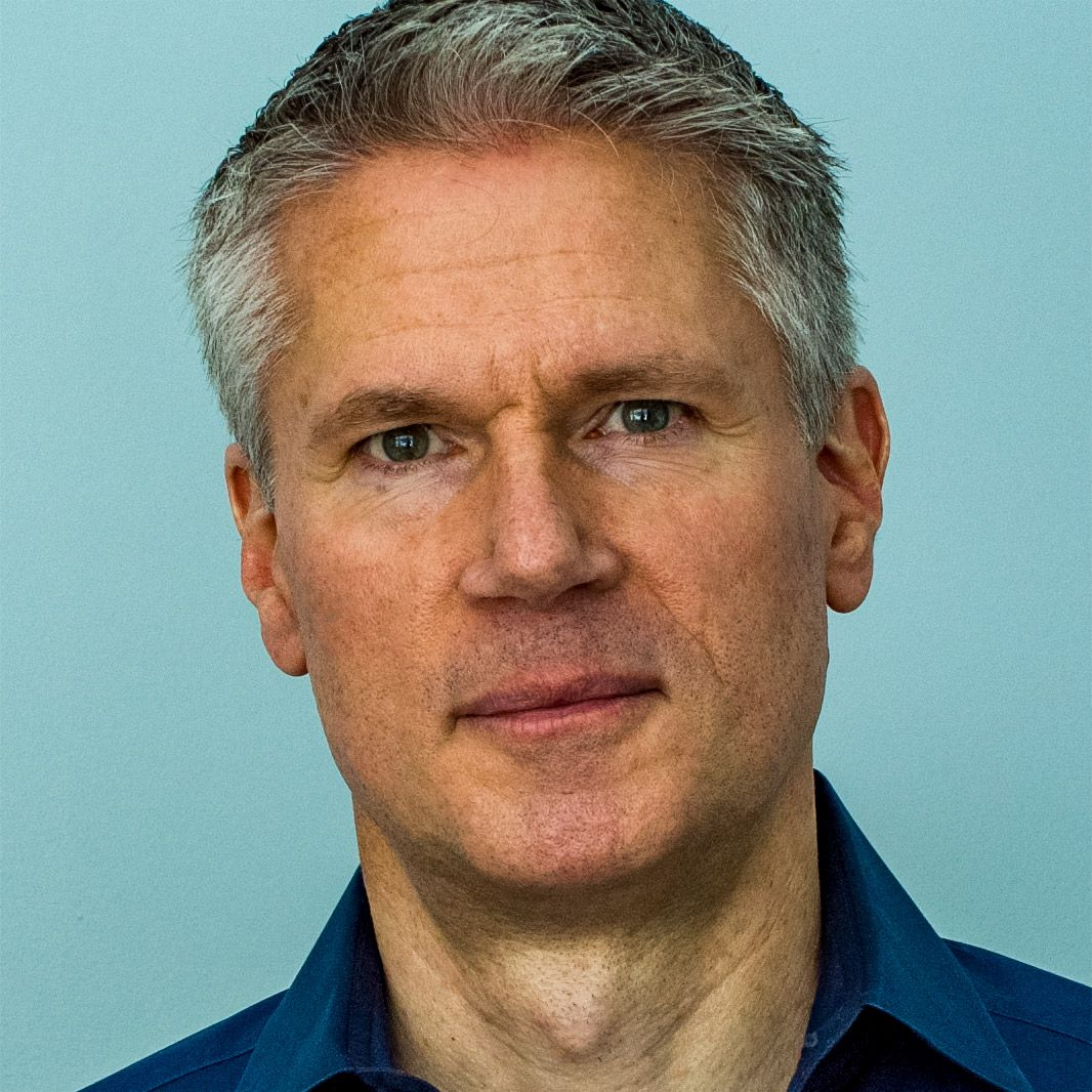 A white man with grey hair looks into the camera. It is Peter Tamte circa 2021.