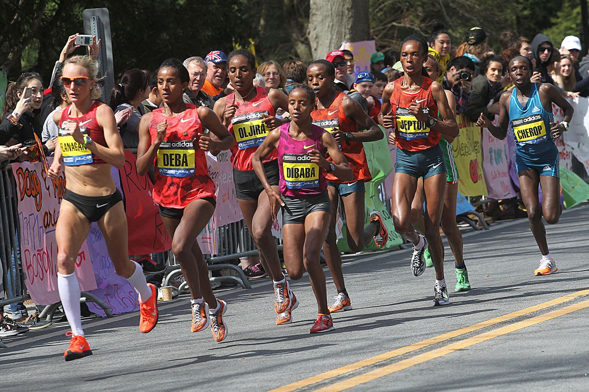 The lead elite women's grouping, including first-place Rita Keptoo, arrives in Wellesley during the 118th Boston Marathon