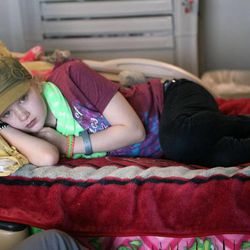 Sarah Magera, 13, who has AML leukemia, hangs out in her room at Primary Children's Medical Center in Salt Lake City on Thursday, Jan. 31, 2013.