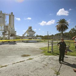 FILE - In this Sept. 10, 2013 file photo, Polk County Sheriff personnel investigate the death of 12-year-old girl, Rebecca Ann Sedwick, at an old cement plant in Lakeland, Fla.
