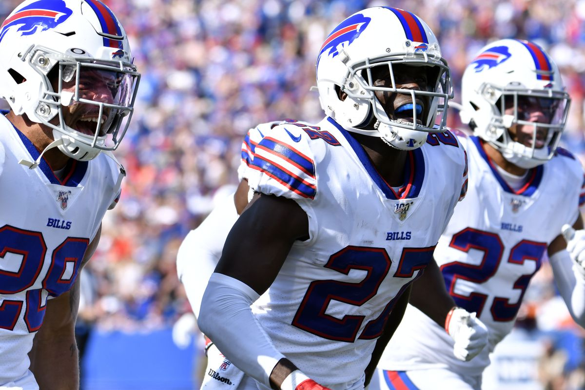 Buffalo Bills cornerback Tre'Davious White flanked by cornerback Kevin Johnson and strong safety Micah Hyde reacts after making an interception in the third quarter at New Era Field.