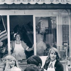 An employee of a Swedish bakery watching a parade on Clark Street in 1967.  Sun-Times Archives