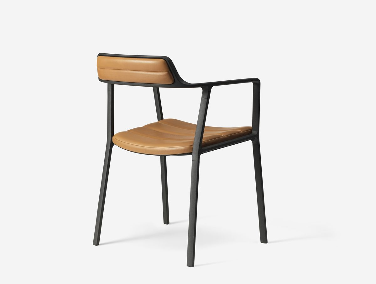 Chair with black frame and camel colored leather