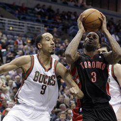 Toronto Raptors' Gary Forbes (3) tries to drive past Milwaukee Bucks' Shaun Livingston (9) during the first half of an NBA basketball game Monday, April 23, 2012, in Milwaukee.