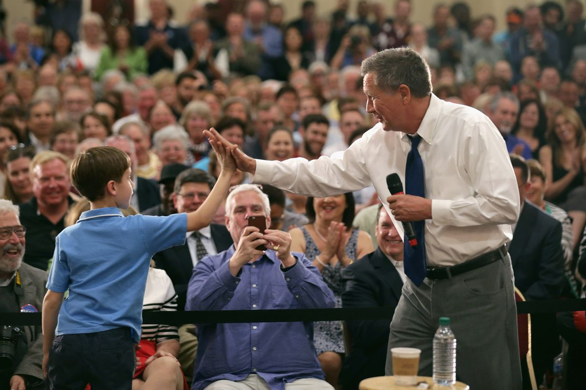 Republican presidential candidate John Kasich giving a high-five to a boy in Maryland, presumably not after winning a state.