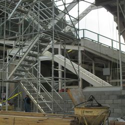 5:10 p.m. The new stairs and wall being built in the right field corner -