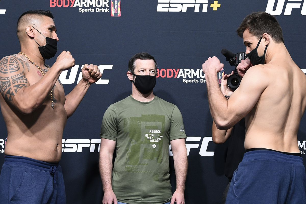 Opponents Ike Villanueva and Jordan Wright face off during the UFC Fight Night weigh-in at UFC APEX on August 21, 2020 in Las Vegas, Nevada.