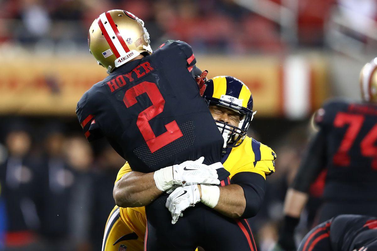 Los Angeles Rams DL Aaron Donald hits San Francisco 49ers QB Brian Hoyer during Week 3, .