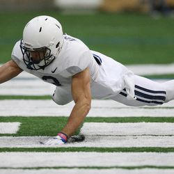 Brigham Young Cougars defensive back Isaiah Armstrong (3) grabs a fumble during an intersquad scrimmage in Provo on Friday, March 23, 2018.