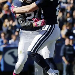 Brigham Young Cougars running back KJ Hall and wide receiver Talon Shumway celebrate a touchdown against the San Jose State Spartans during NCAA football in Provo on Saturday, Oct. 28, 2017.