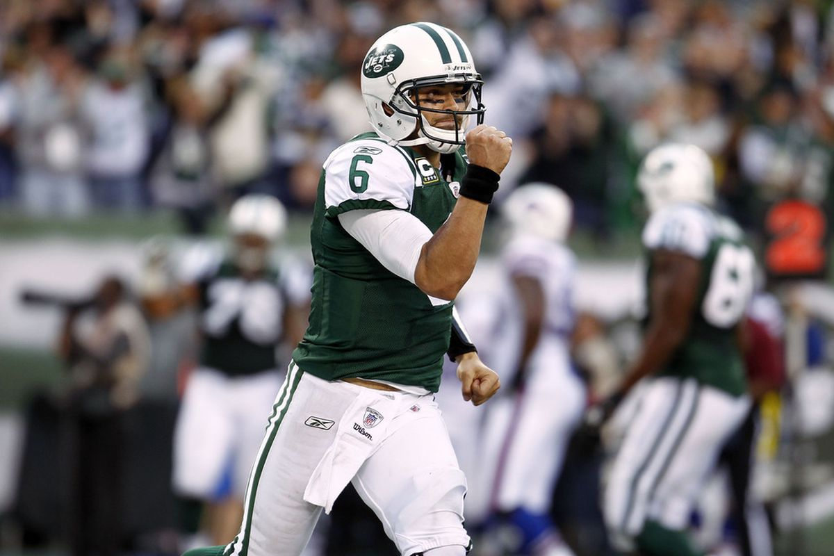 EAST RUTHERFORD, NJ - NOVEMBER 27:  Mark Sanchez #6 of the New York Jets celebrates a touchdown  during a game against the Buffalo Bills at MetLife Stadium on November 27, 2011 in East Rutherford, New Jersey.  (Photo by Jeff Zelevansky/Getty Images)