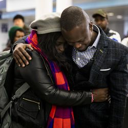 Celestine Mugisha and his wife, Winniefred Akello, embrace at O'Hare International Airport as they are reunited after living apart for more than three years, Jan. 22, 2020. Mugisha and Akello were married in Uganda in September 2016 and, days later, Mugisha moved to Chicago as part of the United States' refugee resettlement program. More than three years later, Akello was also resettled through the program.