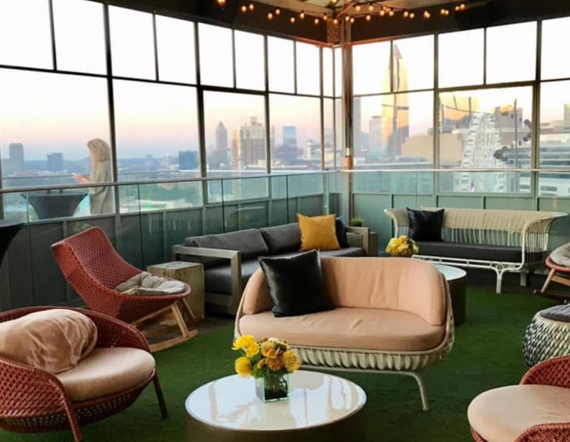A rooftop patio with leather seats offers skyline views.