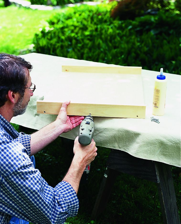 Man Builds Wooden Pull Out Drawer With Drill
