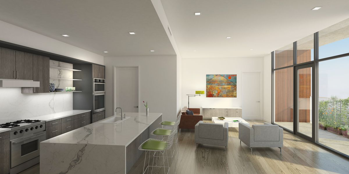 Open-plan mostly white kitchen-living room with wall-sized windows leading to balcony