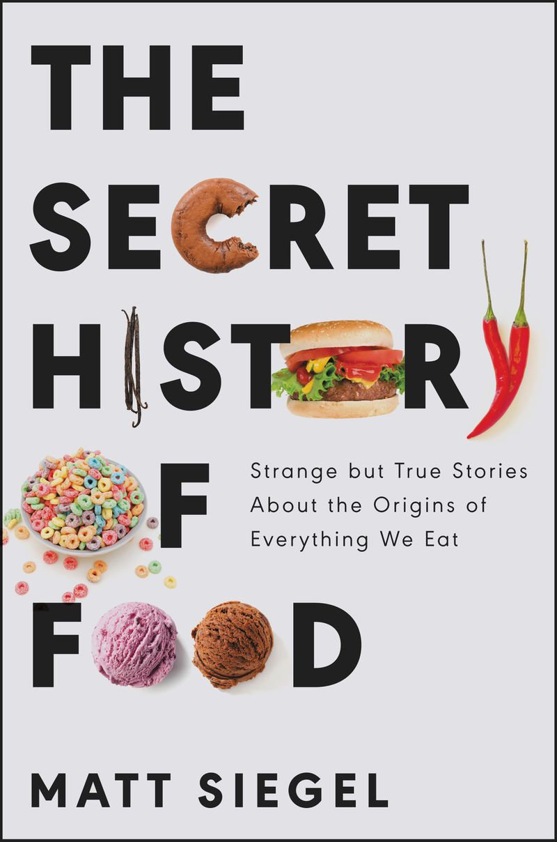 """A book cover with the words The Secret History of Food, in which the letter C is replaced by a bagel with a bite out of it, I is swapped for vanilla bean pods, O is a burger, Y is a chile pepper, O in """"of"""" is a bowl of cereal and the Os in """"Food"""" are ice cream scoops"""