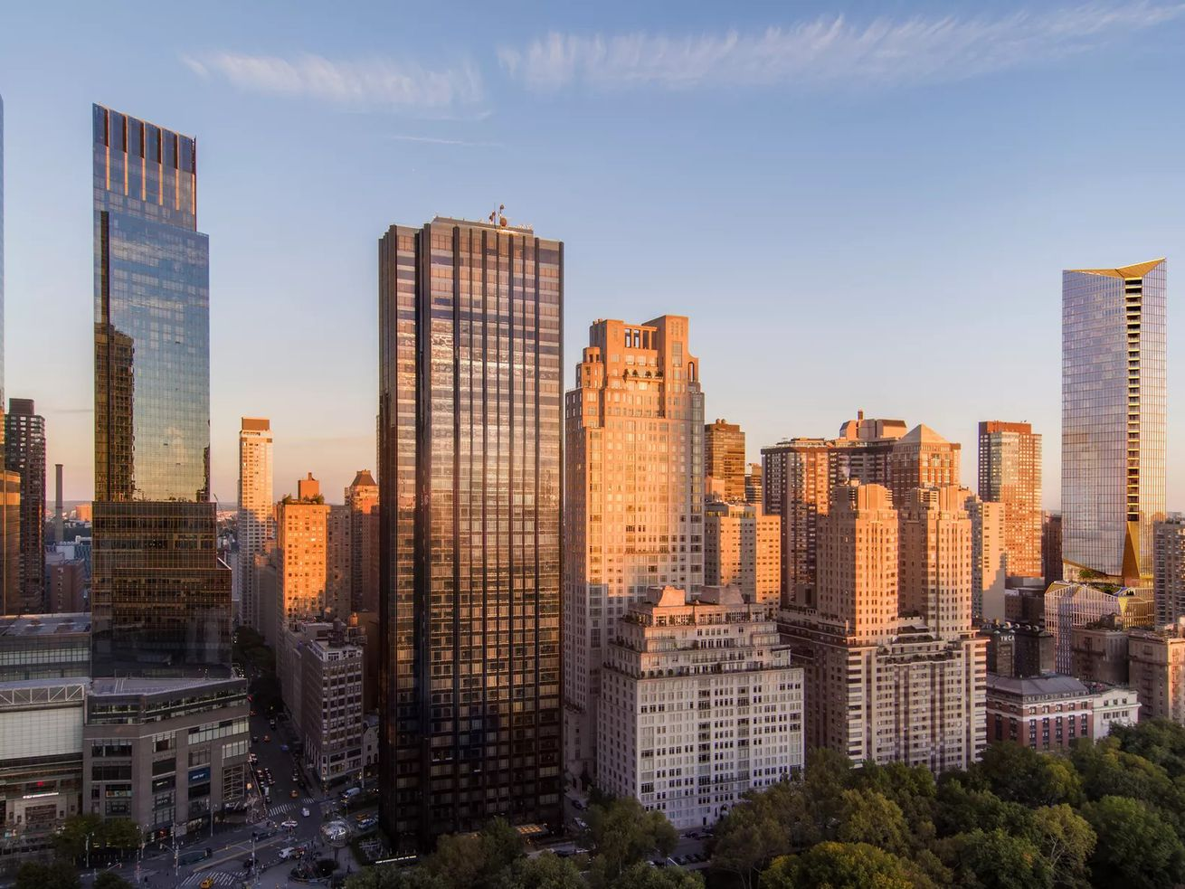 Extell's 50 West 66th Street, at right, will become the Upper West Side's tallest building.