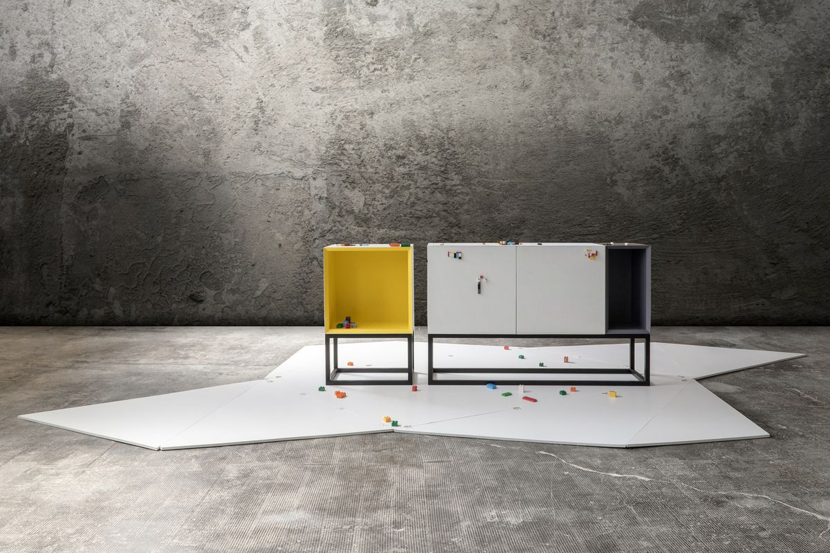 Simple boxy furniture on steel legs feature studded surface compatible with Lego blocks.