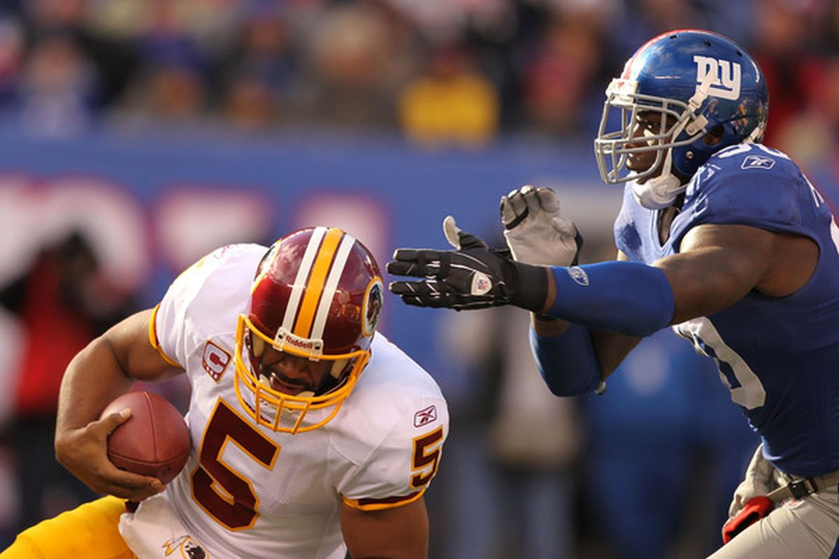 Jason Pierre Paul (90) of the New York Giants Sacks Donovan McNabb (5 )of the Washington Redskins during their game on December 5 2010 at The New Meadowlands Stadium in East Rutherford New Jersey.  (Photo by Al Bello/Getty Images)