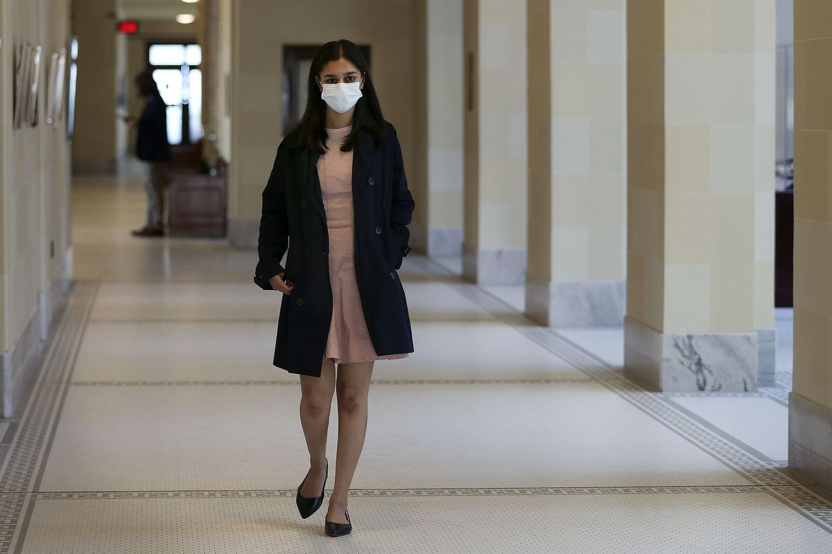 Arundhati Oommen, a West High School student and student member of the Salt Lake City Board of Education, walks to a committee room to testify on HB338 at the Capitol in Salt Lake City on Wednesday, Feb. 24, 2021.The bill, sponsored by Rep. Joel Briscoe, D-Salt Lake City, would allow 16 and 17 year olds to vote in school board races — if permitted by the local school board.
