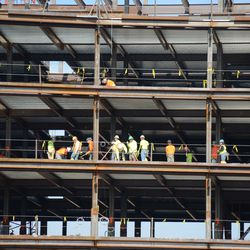 10:57 a.m. Contractors working up in the plaza building. I think they might have been leveling off concrete -