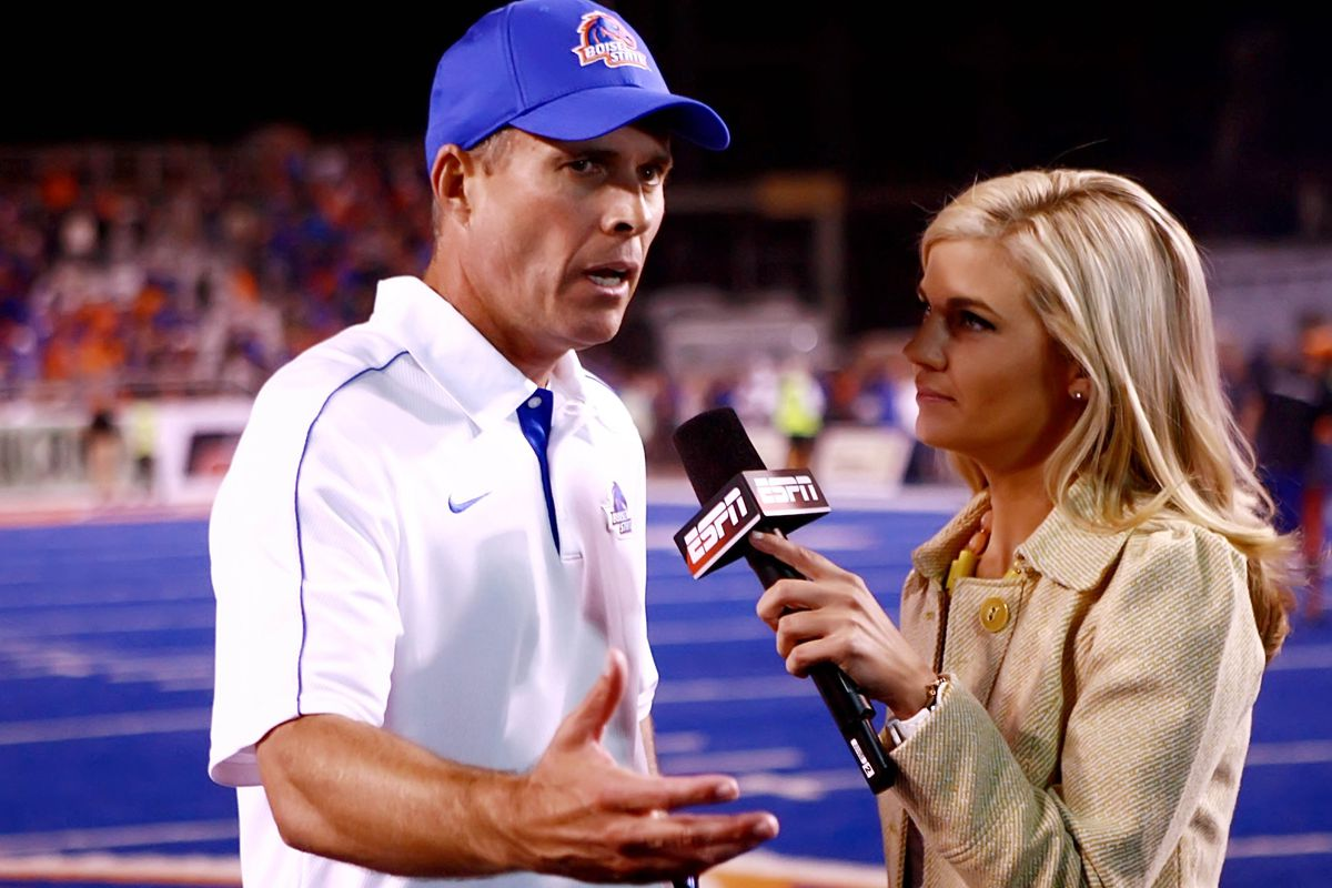 Sep 20, 2012; Boise, ID, USA;  Boise State Broncos head coach Chris Petersen speaks with ESPN reporter Samantha Steele after the game against the BYU Cougars at Bronco Stadium.  Mandatory Credit: Brian Losness-US PRESSWIRE