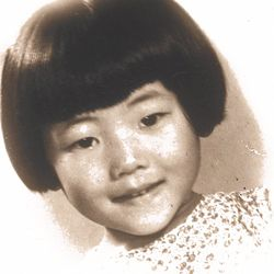 Linda Yu and her family immigrated to the U.S. when Linda was four years old. Linda's passport photo.   Linda Yu Family Photos