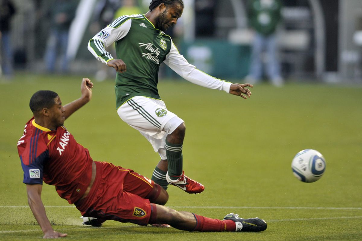 PORTLAND, OR - APRIL 30: Jorge Perlaza #15 of the Portland Timbers dribbles the ball a Real Salt Lake defender during the first half of the game at Jeld-Wen Field on April 30, 2011 in Portland, Oregon. (Photo by Steve Dykes/Getty Images)